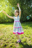 Girl Catch Soap Bubbles Royalty Free Stock Photo