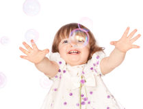 Girl catches the bubbles Royalty Free Stock Image