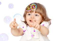 Girl catches the bubbles Stock Photos