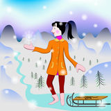 Girl catches first snowflake. Girl with sled looks at the first snow and wants to catch a snowflake Royalty Free Stock Image