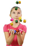 Girl catches gifts falling hands Stock Photo
