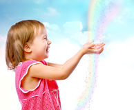 Girl catches rain drops. Little girl catches rain drops on the abstract background royalty free stock photos