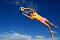 Girl catching ball Stock Photography