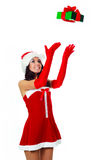 Girl catching a present Royalty Free Stock Images