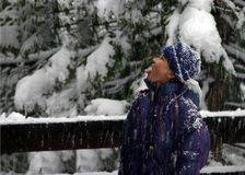 Girl catching snowflakes Stock Image