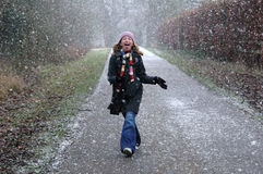 Girl catching snowflakes on her tongue. Nikon D70, lifestyle portrait in snow Royalty Free Stock Photos