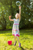 Girl Catching Soap Bubbles Royalty Free Stock Image