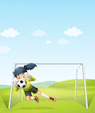 A girl catching the soccer ball under the net Stock Image