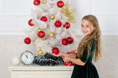Girl celebrate christmas. Child put christmas ornament ball on artificial white tree. Top christmas decorating ideas for. Kids room. Kids can brighten up stock photos