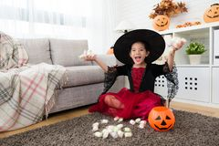 Girl celebrate she own many sweet candies Royalty Free Stock Images