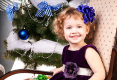 Girl celebrates Christmas Stock Image