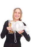 Girl celebrates Christmas with a glass of wine Royalty Free Stock Images