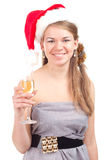 Girl celebrates Christmas with a glass of wine Royalty Free Stock Photography