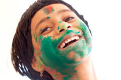 Girl celebrating Holi Stock Image
