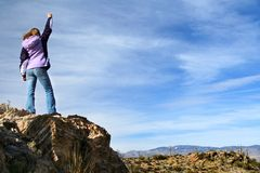 Girl celebrating victory. After climbing a rock. Saguaro National Park, Arizona Stock Photo