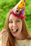 Girl in a celebratory cap Royalty Free Stock Images