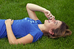 Girl on Cell. Girl laughing talking on cell phone Royalty Free Stock Images