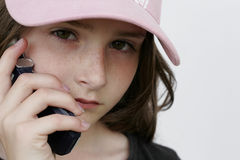 Girl cell. Young girl on cell/mobile phone royalty free stock images