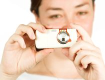 Girl with cell camera phone - focus on mobile Stock Images