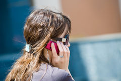 Girl with cell phone Stock Images