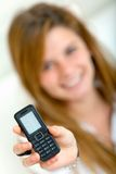Girl with cell phone Royalty Free Stock Photography