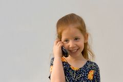 Girl with cell phone. Very young girl holding cell phone Stock Photography