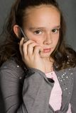 Girl and Cell Phone. Young Girl Holding a Cell Phone stock photos