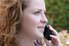 Girl with cell phone. Young pretty girl talking on phone Stock Photos