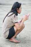 Girl with a cell phone Stock Images