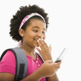 Girl with cell phone. Stock Photography