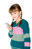 The girl with cell phone. The girl in a color sweater holds mobile phone in a hand Royalty Free Stock Photography