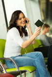 Girl cell phone airport Stock Photography