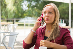 Girl with cell phone. A beautiful young girl with a cell phone Royalty Free Stock Images