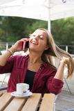 Girl with cell phone. A beautiful young girl with a cell phone Royalty Free Stock Photo