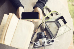 Girl with cell phone, books and old camera Stock Image