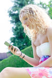 Girl with cell phone Royalty Free Stock Image