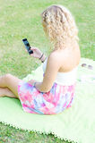 Girl with cell phone Royalty Free Stock Photos