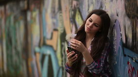 Girl with a cell phone stock footage