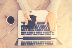 Girl with cell phone, laptop and cup of coffee, vintage photo ef Stock Photos