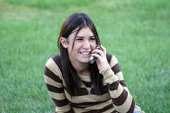 Girl on Cell Phones Royalty Free Stock Photos