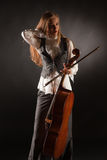 Girl with cello. Studio isolated shot Royalty Free Stock Photo