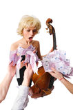 Girl with cello receiving lots of money. Isolated on white Stock Photos