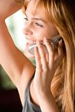 Girl with cellphone. Young woman smiling and keeping mobile phone Royalty Free Stock Image
