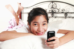 Girl with cellphone Stock Photos
