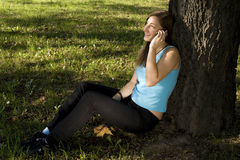Girl with cellphone Stock Images