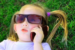 Girl and cellphone Royalty Free Stock Photography