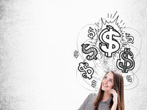 Girl with cellphone and dollar signs Royalty Free Stock Image
