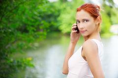 Girl with cellphone outdoors Stock Photography