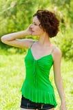 Girl with cellphone outdoors Stock Photos