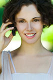 Girl with cellphone outdoors Royalty Free Stock Images